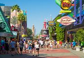 ORLANDO,USA - AUGUST 23, 2014 : A crowd of visitors walking towards the entrance of the Universal Orlando Resort theme parks