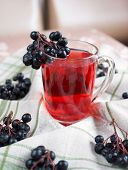 foto of chokeberry  - Compote of black chokeberry on the table