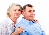 Happy and smiling senior couple in love isolated