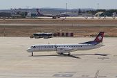 VALENCIA, SPAIN - SEPTEMBER 11, 2014: A Darwin Airline Saab 2000 aircraft taxing to the runway.  Dar