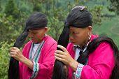 Guilin, China - July 2014: Yao Women Showing Their Long Hair at Jongli Rice Terraces