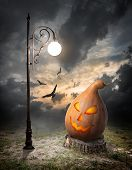 Halloween pumpkin and streetlamp