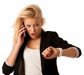 picture of running-late  - Young blonde woman looks at her watch when she is being late isolated over white background - JPG