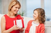 picture of mother and daughter with gift box