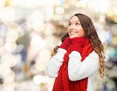 happiness, winter holidays, christmas and people concept - smiling young woman in red scarf and mitt