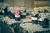 picture of jar jelly  - Many preserving jars with dark jam in a market - JPG