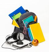 School Backpack  With School Supplies And A Tablet With Headphones.