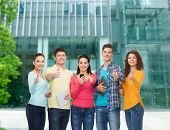 friendship, technology, education, business and people concept - group of smiling teenagers with sma