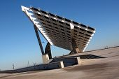 Solar Panels Against The Deep Blue Sky In Spain