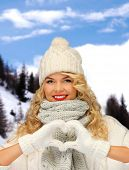 happiness, winter holidays, tourism, travel and people concept - smiling young woman in white hat an