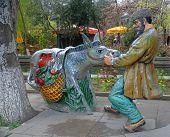 Figure Of A Man Pulling A Stubborn Donkey