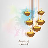 Beautiful illuminated hanging oil lit lamps on colorful abstract background with wishes in Hindi tex