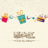 Beautiful greeting card design decorated with gift boxes and arabic islamic calligraphy of text Eid-