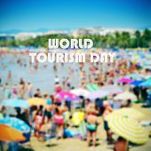 the sentence world tourism day with a crowded beach in the background