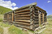 Old log cabin in abadoned mining town in western USA
