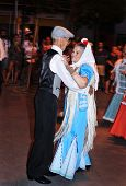 MADRID, SPAIN - AUGUST 10: People dancing the chotis on August 10, 2014 in Madrid, Spain. Chulapos a