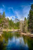 stock photo of granite dome  - Half Dome towers above the Merced river - JPG