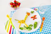 stock photo of aspergers  - Healthy vegetarian lunch for little kids vegetables and fruit served as animals corn broccoli carrots and fresh strawberry helping children to learn eating right and clean - JPG