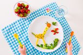 pic of blue animal  - Healthy vegetarian lunch for little kids vegetables and fruit served as animals corn broccoli carrots and fresh strawberry helping children to learn eating right and clean child - JPG