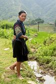 Black Hmong woman in traditional clothes