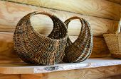 Wicker Basket On The Background Of The Log Wall