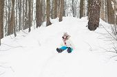 Happy Laughing Child Riding Down A Snowy Hill