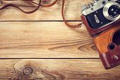 foto of tables  - Old retro camera on wooden table background - JPG
