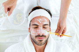 picture of beauty parlour  - Portrait of man with clay facial mask in beauty spa - JPG