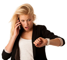 pic of running-late  - Young blonde woman looks at her watch when she is being late isolated over white background - JPG
