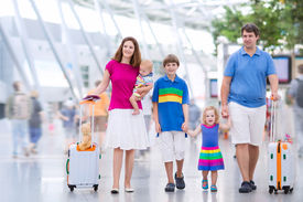 pic of big-girls  - Big happy family with three kids travelling by airplane at Dusseldorf International airport young parents with teenager boy toddler girl and little baby holding colorful luggage for summer beach vacation - JPG