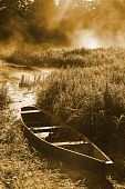 foto of old boat  - Beautiful river and old rowing boat in green grass