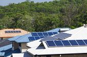 stock photo of efficiencies  - Solar panels on multiple energy efficient homes - JPG