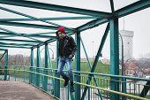 Punk Guy Jumping On A Bridge