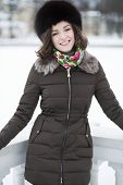 Smiling Woman Dressed In Warm
