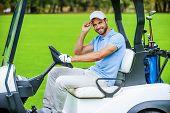 Man Driving Golf Cart.