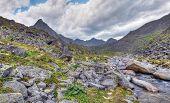 Clastic Rocks Near The Mountain River