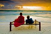picture of breathtaking  - A romantic couple on honeymoon enjoying a breathtaking scene on a tropical beach in Zanzibar Africa - JPG