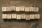 Positive Attitude wooden cubes on a wooden background