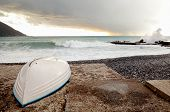 Boat Hull To The Beach With Stormy Weather In The Background