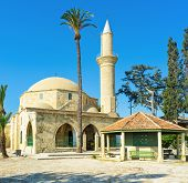 stock photo of sufi  - The complex of Hala Sultan Tekke is the notable landmark located on the bank of Larnaca Salt lake Cyprus.