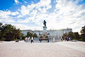 Plaza De Oriente With Tourists On A Spring Day In Madrid
