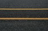 Asphalt Dark Texture With Double Yellow Lines
