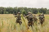 pic of offensive  - group of rangers conducting an offensive against the enemy - JPG