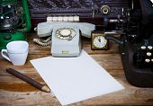 image of typewriter  - Still life with retro typewriter alarm clock telephone and old things. ** Note: Shallow depth of field - JPG