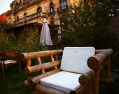 Comfortable wooden chair in a garden