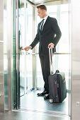 Businesswoman In Elevator.