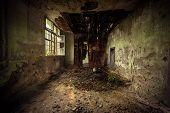 Dark room interior with damaged roof