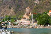 picture of gang  - The town of Rishikesh and the Lakshman Jhula bridge spanning the river Ganges in India - JPG