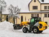 Bulldozer Under A Snowfall