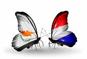 stock photo of holland flag  - Two butterflies with flags on wings as symbol of relations Cyprus and Holland - JPG